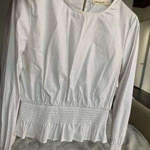 White peplum long sleeve shirt